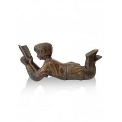 brass girl reads