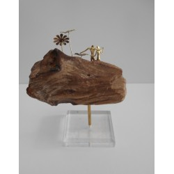 Couple on wooden rock.